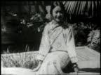 Anna May Wong in a garden