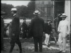 Wright brothers and crew bringing their airplane out of a barn / United States