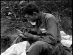 April 7 1951 MONTAGE Soldier writing a letter / Korea