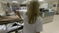 October 14 2009 PAN Nurses wheeling patient on gurney / Memphis Tennessee United States