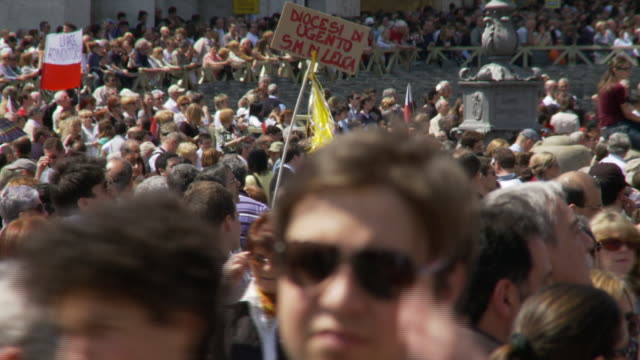 April 24 2006 MONTAGE Crowded street audience listening to Pope Benedict's weekly service in St Peter's Square / Vatican City Rome Italy