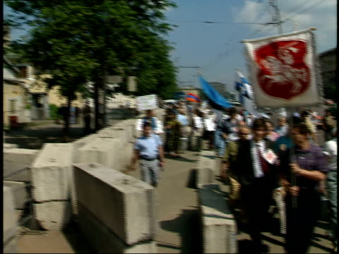 July 3 1987 TU Protesters for Estonia marching carrying posters and waving flags beneath the US Embassy / Moscow Russia