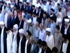 HA Congregation of worshipers standing while observing midday prayer / Qom Iran