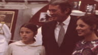 Jacqueline and Caroline Kennedy and Aristotle Onassis with civilians and military personnel at commissioning reception aboard USS John F Kennedy /...
