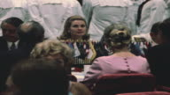 PAN Jacqueline Kennedy and Aristotle Onassis dining with civilians and officers of USS John F Kennedy at commissioning reception / Portsmouth...