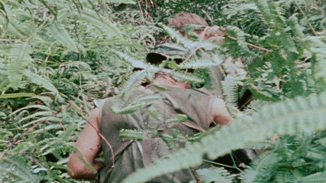 MONTAGE 327th Infantry Regiment soldiers climbing hill through dense jungle sentry guarding path overlooking mountainous jungle / Vietnam