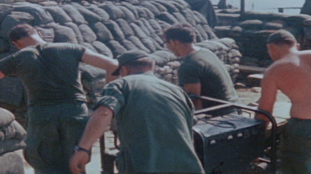 MONTAGE 101st Airborne Division soldiers carrying and installing generator at fire support base / Vietnam