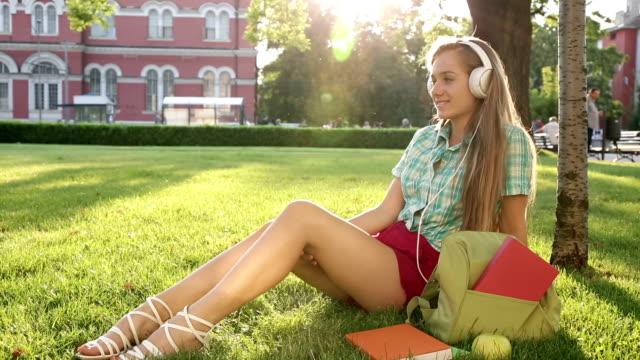 1080p Blond school girl listening to music