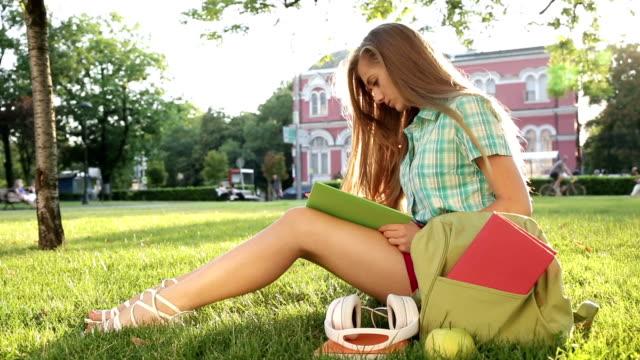 1080p School girl reading a textbook