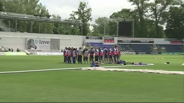 England cricketers hold minutes silence WALES Cardiff EXT England Cricket team standing in circle and observing 1 minute silence on pitch during...