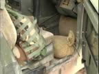 15th Jan 2004 MONTAGE US soldiers protecting vehicles with makeshift scraps / LSA Anaconda Iraq / AUDIO