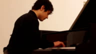 16yearold Pianist Tambi Asaad Cimuk who is granted Turkish citizenship through a special decree by Turkish President Recep Tayyip Erdogan perform...