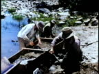 1850s REENACTMENT MONTAGE Gold prospectors using tom to separate gold from soil, USA, AUDIO