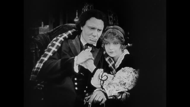 1860s Woman (Lillian Gish) fixes her father's (Ralph Lewis) wig before sharing a tender moment with him