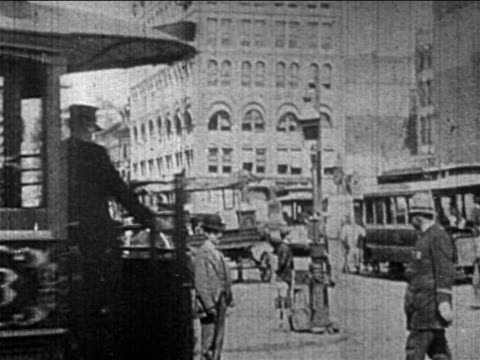 B/W 1890s pedestrians + traffic on NYC street / trolley with 'Broadway' written on side passing camera