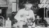 1900s B/W MONTAGE Thomas Edison works in his lab and turns on light bulb / United States
