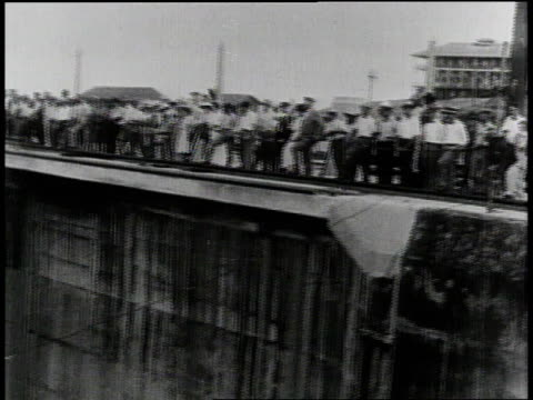 1910s B/W onlookers standing and staring down into the Panama Canal / Panama