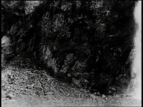 1910s B/W Trains moving near the Panama Canal past mountains and waterfall / Panama