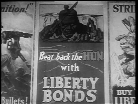 B/W 1910s close up antiGerman poster advertising Liberty Bonds / World War I / newsreel