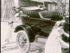 1910s MONTAGE children pushing a Model T as man tries to start it / United States