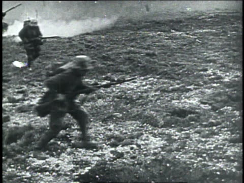 1910s MONTAGE German soldiers advancing in field with shells exploding around them machine gunner in trench / Germany