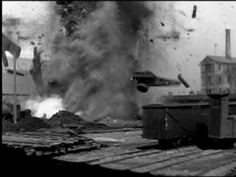 B/W 1910s REENACTMENT large explosion in train yard (model) (World War I movie) 'The Dawn Patrol'