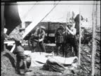 1910s WS soldiers chopping at sides of meat / Kars Austria