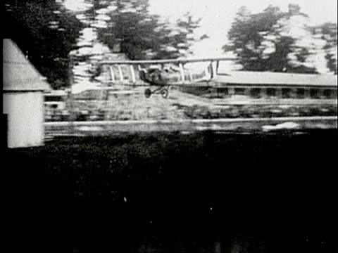 1920s B/W MS, PAN, Biplane crushing into barn on landing