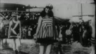 1920s B/W MONTAGE Models presenting bathing suits / USA
