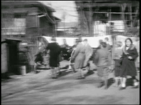 B/W 1920s children running + playing outdoors / Japan / home movie