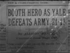 COLLEGE FOOTBALL Newspaper article heading 'Booth HeroYale Defeats Army 2113' HA WS Football game play ball is kicked TRACKING ball caught by...