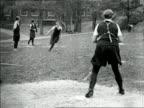 B/W 1920s girls running to home plate in girls' baseball game outdoors / short subject
