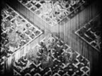B/W 1920s high angle four floor pieces with women lying on them merging in floorshow / Paris / newsreel