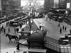 B/W 1920s high angle pedestrians + traffic by subway stop at Times Square / NYC / commercial