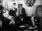 B/W 1920s jazz band playing + legs of can-can dancers kicking (2 shots) / Paris / documentary