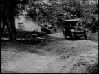 1920s MONTAGE President Warren G Harding arrives by car to a campsite in the Great Smokey Mountains / North Carolina United States