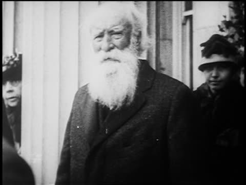 B/W 1920s naturalist John Burroughs with long white beard waving hat outdoors