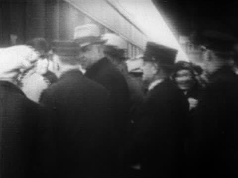 B/W 1920s police escorting gangster Legs Diamond onto train / newsreel