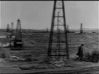TEAPOT DOME SCANDAL HA WS PAN Public land w/ houses oil derricks male walking oil field WS Water tank w/ 'Teapot Wyo water supply' painted on side MS...