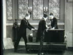 1920s WS Three magicians sawing woman in half
