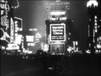B/W 1920s wide shot lights + signs at Times Square at night / New York City
