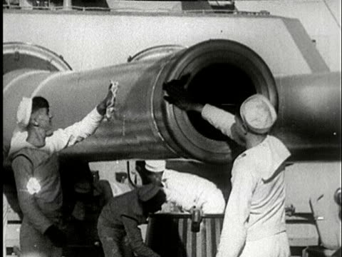 1930s B/W MS, Navy soldiers polishing cannon on ship deck