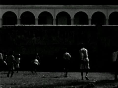 1930s B/W WS Young boys playing in courtyard / Haiti