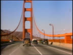 1930s car point of view driving over Golden Gate Bridge towards Marin County / documentary