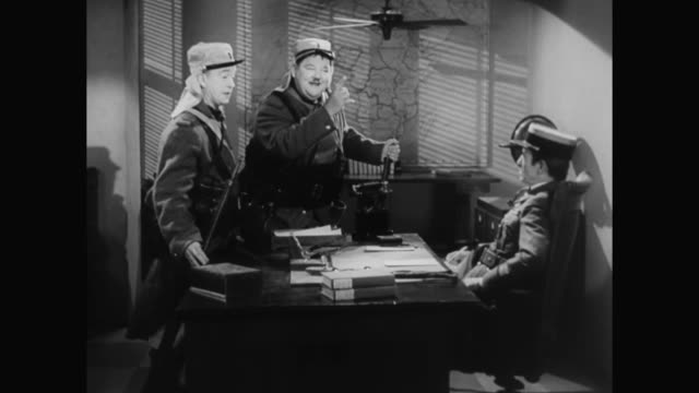 Laurel and Hardy negotiate salary with their superior