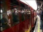 1930s London Underground train journeys along Northern Line ENGLAND London EXT Bright red 1938 London Underground train pulling into station platform...