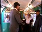 1930s London Underground train journeys along Northern Line EXT London Underground staff dressed in 1930's period costume boarding tube train...