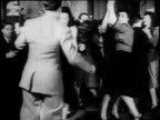 1930s MONTAGE Couples on dance floor doing the jitterbug with live band playing / United States