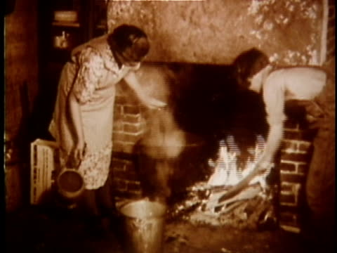 1930s MONTAGE Women doing housework with use of fire, USA, AUDIO