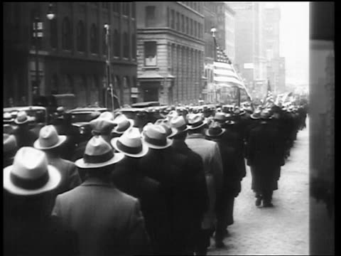 B/W 1930s REAR VIEW men marching in parade on city street / AntiHitler demonstration / NYC